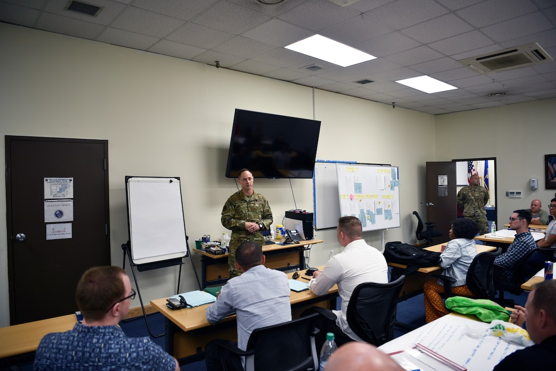 U.S. Air Force Col. Tad Clark, 8th Fighter Wing commander, encourages the airmen to be innovative and use the tools they are learning at the Continuous Process Improvement class at Kunsan Air Base, Republic of Korea, July 11, 2019. Clark visited the class to declare his intent to create a culture of innovation at the Wolf Pack, and to inspire airmen to use their voices and perspectives to help make Kunsan a better place than when they arrived. (U.S. Air Force photo by Technical Sgt. Joshua P. Arends)