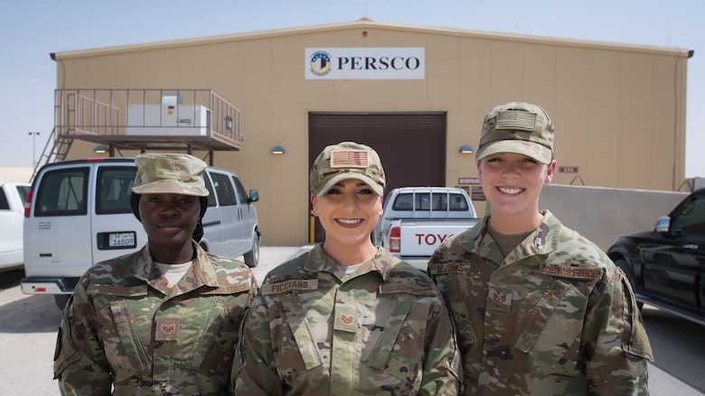 Airmen assigned to the 386th Expeditionary Force Support Squadron Personnel Support for Contingency Operations (PERSCO) team pose for a photo at Ali al Salem Air Base, Kuwait, Aug. 6, 2019. PERSCO accounts for Airmen transitioning to and from the U.S. Central Command area of responsibility. (U.S. Air Force photo by Tech. Sgt. Daniel Martinez)