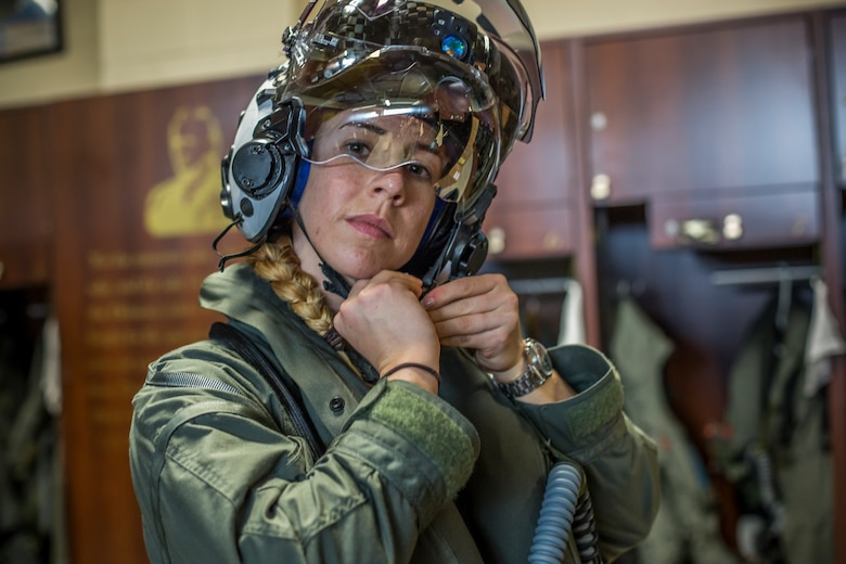 Capt. Anneliese Satz puts on her flight helmet prior to a training flight aboard Marine Corps Air Station Beaufort, March 11. Satz graduated the F-35B Lighting II Pilot Training Program June and will be assigned to Marine Fighter Attack Squadron 121 in Iwakuni, Japan.