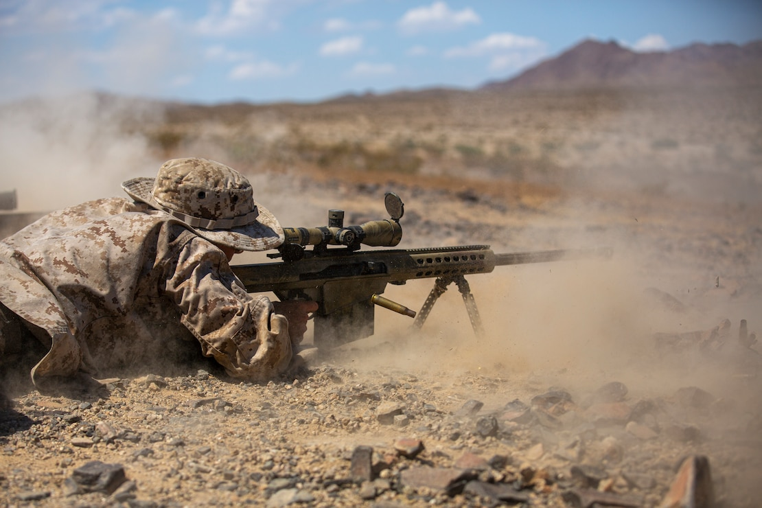 A U.S. Marine with Scout Sniper Platoon, Weapons Company, 1st Battalion, 25th Marine Regiment, 4th Marine Division battle sight zeros a Special Aplication Scoped Rifle, on Twenty-Nine Palms, Calif. July 26, 2019. The Marines of Scout Sniper Platoon executed Know and Unknown Distance ranges in order to prepare themselves for Inegrated Training Exercize 5-19.