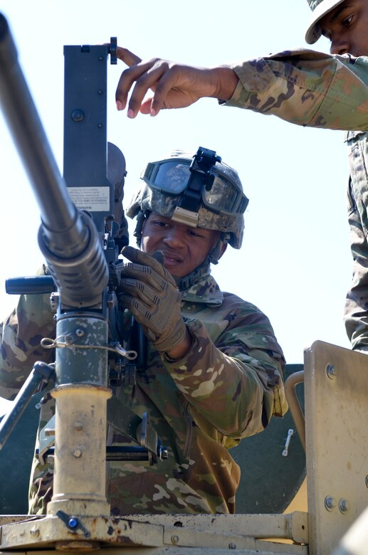 Private 1st Class Jonathan Cruzarce (right), 439th Quartermaster Co., 316th Sustainment Command (Expeditionary), assists Sgt. Christopher Downie (left), in the same unit, with attaching a thermal weapon sight to an M2.50 caliber machine gun on a mounted gunnery range during Operation Cold Steel Task Force Fortnite hosted by the 377th Theater Sustainment Command at Ft. McCoy, Wis. April 16, 2019.