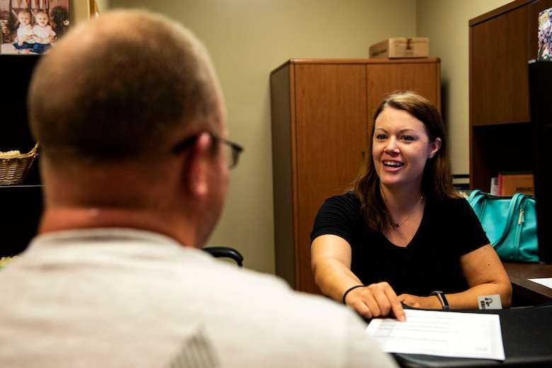 Sandra Stuart, right, 23d Medical Group health promotion dietitian, and Tech. Sgt. John Faggard, 23d Aircraft Maintenance resource advisor, go over his body composition results, Aug. 9, 2019, at Moody Air Force Base, Ga. As a board-certified sports dietitian, Stuart helps Airmen make the best use of the nutrition involved in their exercise, helping maximize their fitness. (U.S. Air Force photo by Senior Airman Erick Requadt)
