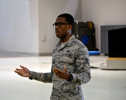 Senior Airman Michael Cage, a Home Station Check shop crew chief with the 445th Maintenance Squadron, addresses fellow Airmen during a morale group brief July 14, 2019.