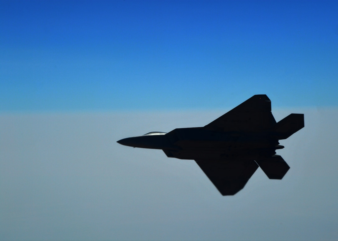 An F-22 Raptor flies above an undisclosed location
