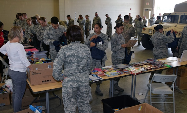 433rd Airlift Wing members pick up school supplies Aug. 4 at Joint Base San Antonio-Lackland. The Lackland Exceptional Family Member Program and the San Antonio Lighthouse for the Blind & Vision Impaired teamed together to provide no-cost backpacks and back-to-school supplies to Reserve Citizen Airmen with the Alamo Wing.