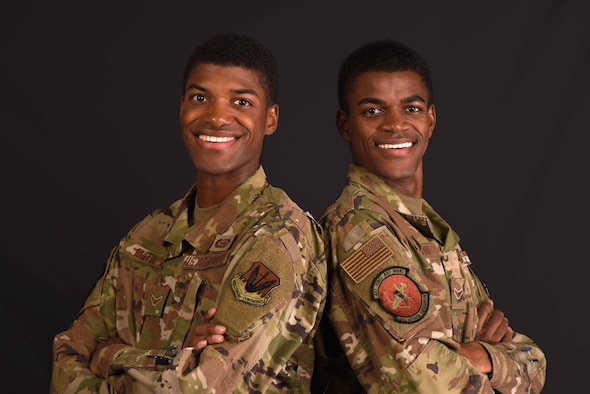 From left, Airmen 1st Class Leernest Ruffin and LeNard Ruffin, 482nd Attack Squadron intel analysts, stand together at Shaw Air Force Base, South Carolina, July 29, 2019.