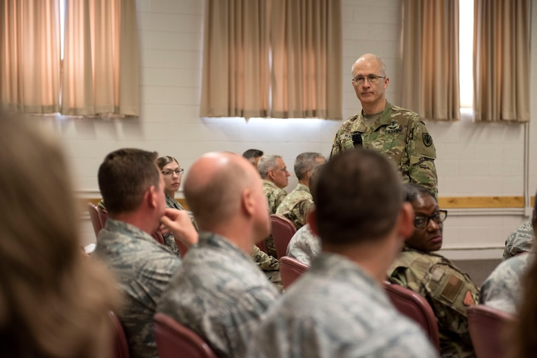 Maj. Gen. Ronald Place, Defense Health Agency acting assistant director for healthcare administration, listens to a question regarding DHA transition, Aug. 8, 2019, on Holloman Air Force Base, N.M. Place visited to ensure 49 MDG Airmen understand how the changes will affect medical group operations. (U.S. Air Force photo by Staff Sgt. Christine Groening)