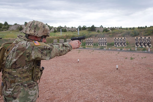 Sgt. Tyler Goldade, North Dakota Army National Guard, shoots a course of fire July 27, 2019, at Camp Guernsey, Wyo., during the Marksmanship Advisory Council Region 6 Championship. Goldade won the Combined Arms Individual Aggregate and Combined Arms Individual Rifle Champion.