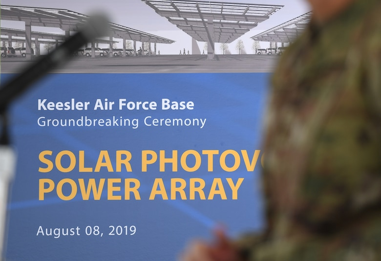 An artist's rendering of the new solar photovoltaic power array project is on display during a groundbreaking ceremony at the commissary parking lot on Keesler Air Force Base, Mississippi, Aug. 8, 2019. The ceremony introduced the project with NORESCO United Technologies, which will provide 497 solar panels on the exchange and commissary parking lot, generating over 2 million kilowatts annually as well as providing shade and shelter from inclement weather to the parked cars. It is scheduled for completion in May 2021. (U.S. Air Force photo by Kemberly Groue)