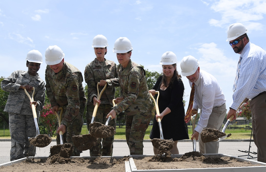 Keesler leadership and project officials participate in a groundbreaking ceremony at the commissary parking lot on Keesler Air Force Base, Mississippi, Aug. 8, 2019. The ceremony introduced the project with NORESCO United Technologies, which will provide 497 solar panels on the exchange and commissary parking lot generating over 2 million kilowatts annually, as well as providing shade and shelter from inclement weather to the parked cars. It is scheduled for completion in May 2021. (U.S. Air Force photo by Kemberly Groue)
