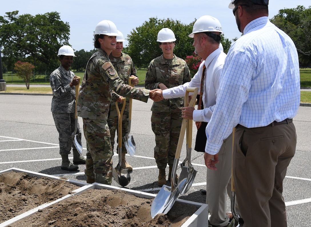 U.S. Air Force Col. Heather Blackwell, 81st Training Wing commander, shakes hands with project officials during a groundbreaking ceremony at the commissary parking lot on Keesler Air Force Base, Mississippi, Aug. 8, 2019. The ceremony introduced the project with NORESCO United Technologies, which will provide 497 solar panels on the exchange and commissary parking lot generating over 2 million kilowatts annually, as well as providing shade and shelter from inclement weather to the parked cars. It is scheduled for completion in May 2021. (U.S. Air Force photo by Kemberly Groue)