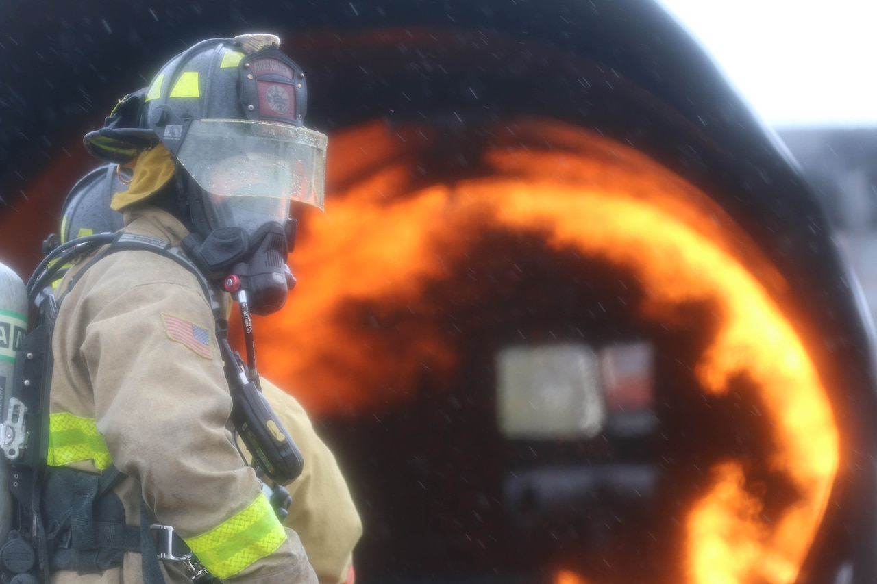 Firefighter prepares to extinguish blaze