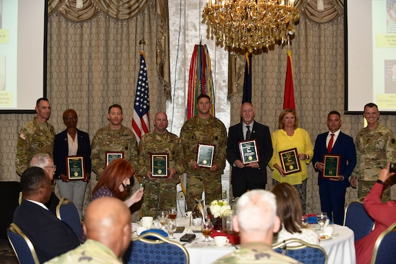 Gen. Paul E. Funk II, commanding general, U.S. Army Training and Doctrine Command, and TRADOC Command Sgt. Maj. Timothy A. Guden, pose for a group photo with the 2019 TRADOC Instructors of the Year at Fort Eustis, Va., Aug. 7, 2019. The seven awardees were recognized during the TRADOC Commander's Forum. (U.S. Army photo by Angel Clemons)