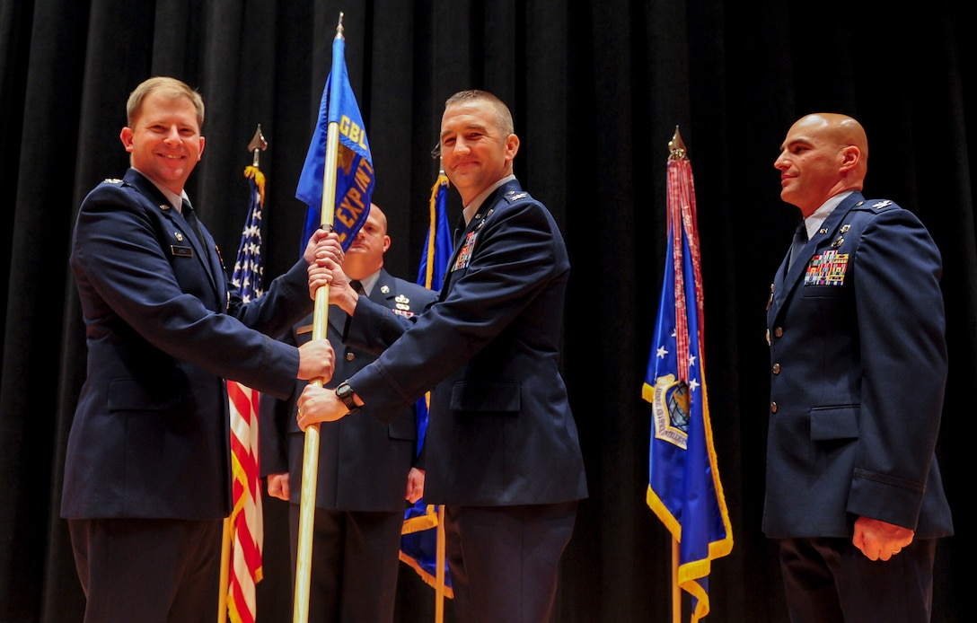 Col. Duane J. Diesing accepts command of the National Air and Space Intelligence Center's Global Exploitation Intelligence Group from Col. Parker H. Wright, NASIC commander, July 27. GX is responsible for executing analysis of signals intelligence, human intelligence, open source intelligence, and foreign materiel exploitation to create integrated intelligence for NASIC and the nation. (Air Force photo by Senior Airman Michael J. Hunsaker)