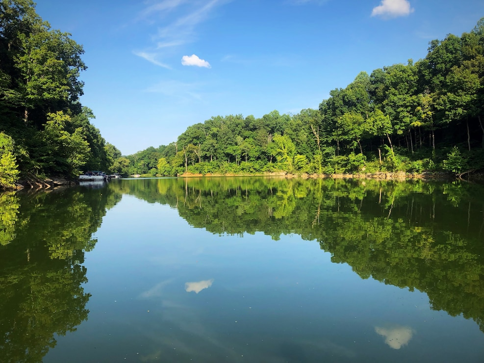 The still lake mirrors trees at Brier Creek on Nolin River Lake in Bee Spring, Ky.