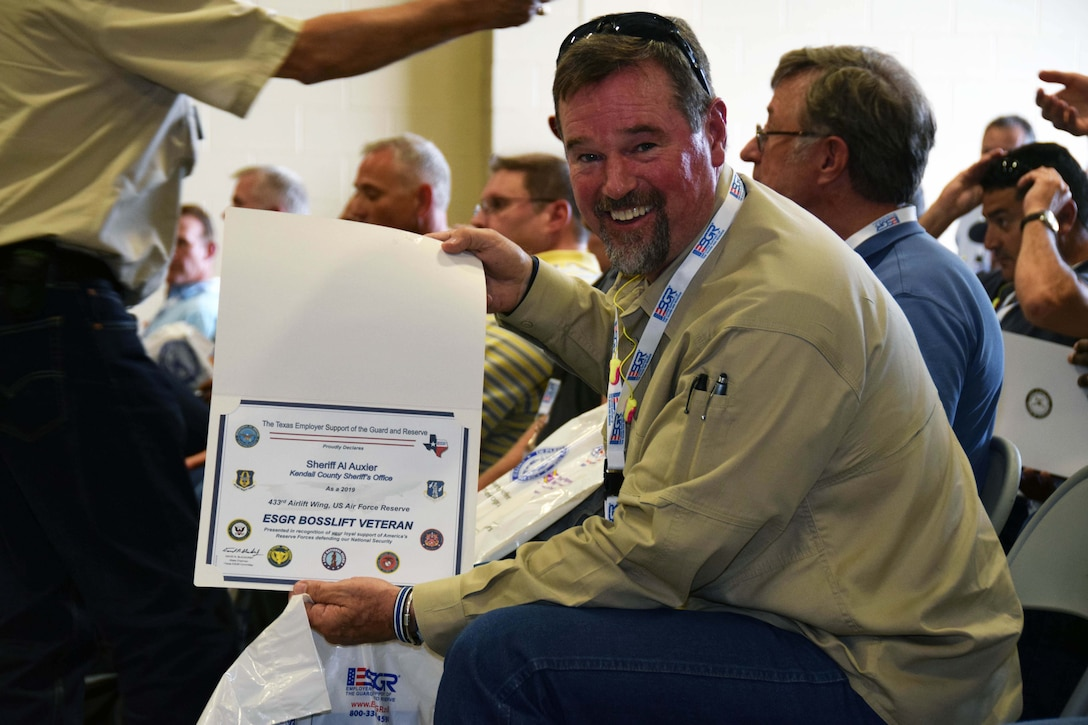 Kendall County Sheriff Al Auxier shows-off a certificate presented to him after completing the Employer Support of Guard and Reserve Bosslift event at Joint Base San Antonio-Lackland, Texas Aug. 3, 2019.