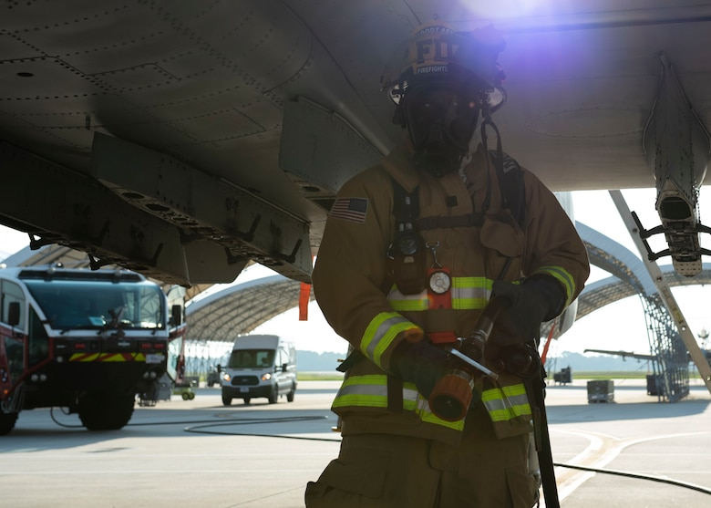Airman 1st Class Lakeem Coleman, 23d Civil Engineer Squadron (CES) firefighter, carries a hose during an A-10C Thunderbolt II egress training scenario, Aug. 9, 2019, at Moody Air Force Base, Ga. The 23d CES conducted the exercise to test their capability in extinguishing an A-10 on fire while simultaneously rescuing its pilot. The training also served as an opportunity for firefighter crew chiefs and their Airmen to increase team cohesion. (U.S. Air Force photo by Airman Azaria E. Foster)