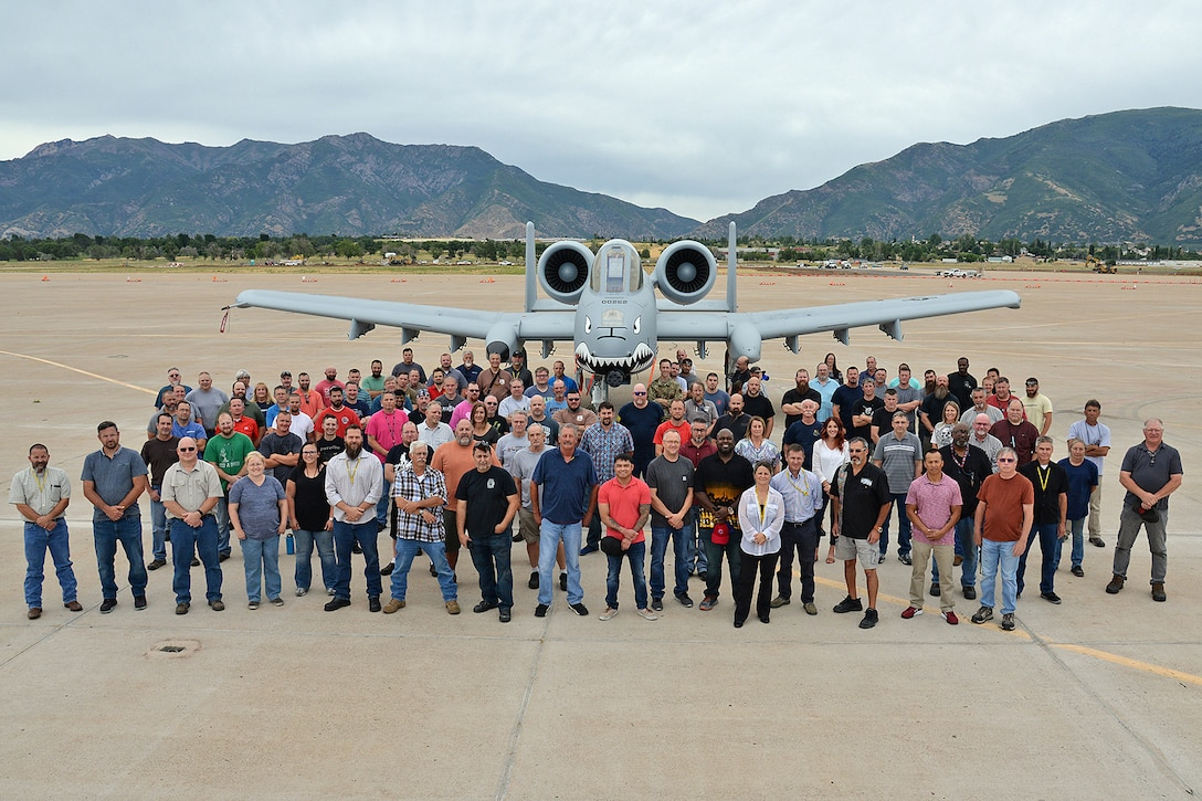 571st Aircraft Maintenance Squadron members in front of an A-10 Thunderbolt II, tail no. 80-0252, at Hill Air Force Base, Utah, July 31, 2019. The aircraft is from the Moody Air Force Base, Georgia, home of the 23d Wing Flying Tigers, a unit that traces its lineage back to the Flying Tigers of WWII that painted sharks teeth on the nose of the P-40 Warhawk fighter planes they flew. This is the last of 173 A-10 aircraft to receive new wings under the Enhanced Wing Assembly program to extend the flying service life of the A-10 fleet.  (U.S. Air Force photo by Alex R. Lloyd)