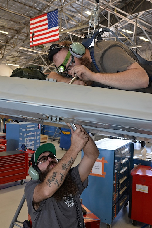 571st Aircraft Maintenance Squadron technicians Bridger Bodily (right) and Ryan Peterson, rig flight controls on the new Enhanced Wing Assembly on an A-10 Thunderbolt II, tail no. 80-0252, at Hill Air Force Base, Utah, June 16, 2019. The new wing is the last of 173 new wings that were produced to extend the flying service life of the A-10 fleet.  (U.S. Air Force photo by Alex R. Lloyd)
