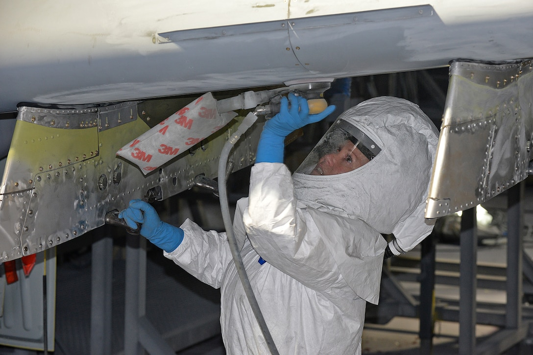 576th Aircraft Maintenance Squadron corrosion control painter Kimberly Hight sands down the underside of the new wing on A-10 Thunderbolt II, tail no. 80-0252, at Hill Air Force Base, Utah, June 28, 2019. The aircraft was the last of 173 A-10s to receive new wings under the Enhanced Wing Assembly program to extend the flying service life of the fleet.  (U.S. Air Force photo by Alex R. Lloyd)