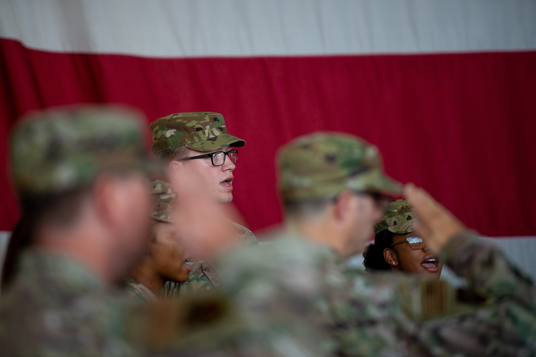 Airmen sing the national anthem in a trio at the 56th Mission Support Group change of command July 29, 2019, at Luke Air Force Base, Ariz.