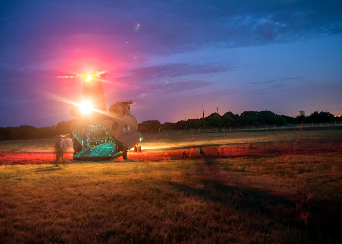Staff Weather Officers (SWO) from the 3d Weather Squadron, depart a CH47-Chinook during a certification field exercise (CFX), July 29, 2019, at Camp Bowie Training Center, Texas.  The CFX was designed to evaluate the squadron's overall tactical ability and readiness to provide the U.S. Army with full spectrum environmental support to the Joint Task Force (JTF) fight. (U.S. Air Force photo by Airman 1st Class Eugene Oliver)