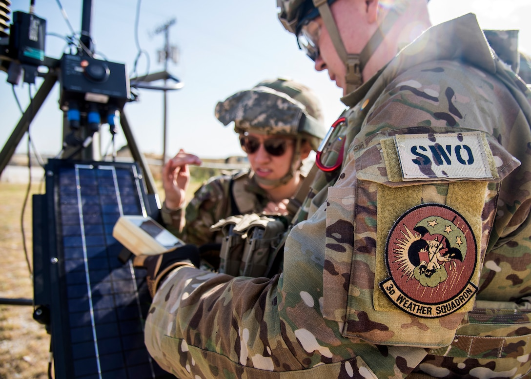 Staff Weather Officers (SWO) from the 3d Weather Squadron (WS), inspect a tactical meteorlogical observing system, during a certification field exercise (CFX), July 29, 2019, at Camp Bowie Training Center, Texas. The CFX was designed to evaluate the squadron's overall tactical ability and readiness to provide the U.S. Army with full spectrum environmental support to the Joint Task Force (JTF) fight. While deployed, the Army relies on the 3d WS to provide them with current ground weather reports. These reports are then employed by commanders on the ground as they plan the best tactics and approaches to accomplish the mission. (U.S. Air Force photo by Airman 1st Class Eugene Oliver)