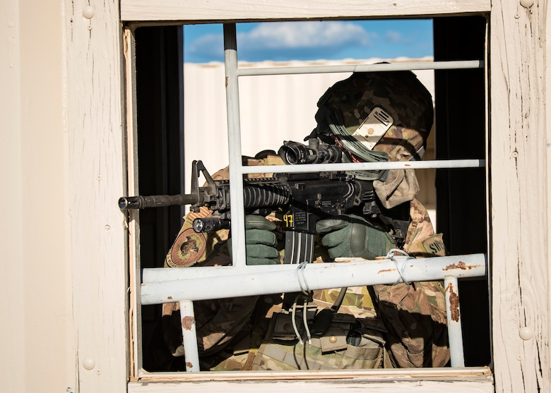 A Staff Weather Officer from the 3d Weather Squadron, fires an M4 Carbine during a certification field exercise (CFX), July 29, 2019, at Camp Bowie Training Center, Texas. The CFX was designed to evaluate the squadron's overall tactical ability and readiness to provide the U.S. Army with full spectrum environmental support to the Joint Task Force (JTF) fight. The CFX immersed Airmen into all the aspects of what could come with a deployment such as force on force scenarios. (U.S. Air Force photo by Airman 1st Class Eugene Oliver)