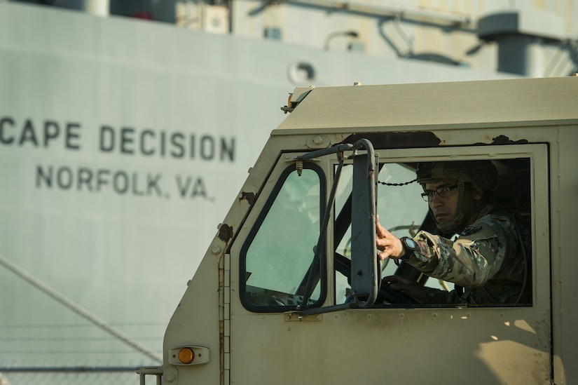 A U.S. Army Soldier prepares to drive a military vehicle onto Logistics Naval Vessel Cape Decision during Exercise Dragon Lifeline Aug. 7, 2019, at the Federal Law Enforcement Training Center in Charleston, S.C. The deployment readiness exercise combined the capabilities of service members from Fort Bragg, N.C., Joint Base Charleston, S.C., and Joint Base Langley-Eustis, Va., and focused on the rapid deployment of equipment, vehicles and personnel. Participants shared knowledge and tested their efficiency in moving assets by air, land, rail and sea during the training event. The annual exercise is just one of the critical readiness exercises the DOD conducts to maintain a lethal and ready force. (U.S. Air Force photo by Tech. Sgt. Christopher Hubenthal)