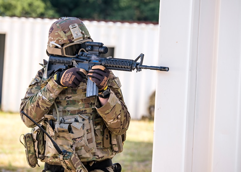 Staff Sgt. Austin Buckhalter, 3d Weather Squadron weather forecaster, fires an M4 Carbine during a certification field exercise (CFX), July 29, 2019, at Camp Bowie Training Center, Texas. The CFX was designed to evaluate the squadron's overall tactical ability and readiness to provide the U.S. Army with full spectrum environmental support to the Joint Task Force (JTF) fight. The CFX immersed Airmen into all the aspects of what could come with a deployment such as force on force scenarios. (U.S. Air Force photo by Airman 1st Class Eugene Oliver)