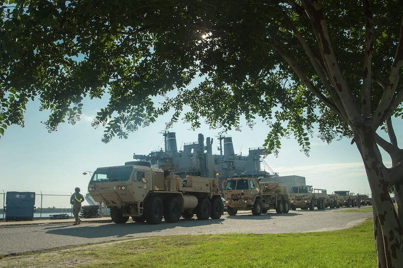 U.S. Army vehicles are staged prior to being moved onto the Logistics Naval Vessel Cape Decision during Exercise Dragon Lifeline Aug. 7, 2019, at the Federal Law Enforcement Training Center in Charleston, S.C. The exercise provided military personnel with experience needed to support rapid deployment operations across air, land, rail and sea. JB Charleston helps to provide rapid global deployment of personnel and equipment to deployed locations across the globe. The annual exercise is just one of the critical readiness exercises the DOD conducts to maintain a lethal and ready force. (U.S. Air Force photo by Tech. Sgt. Christopher Hubenthal)