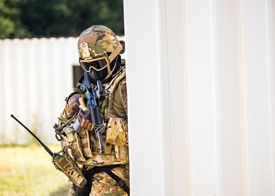 A Staff Weather Officer from the 3d Weather Squadron, takes cover during a certification field exercise (CFX), July 29, 2019, at Camp Bowie Training Center, Texas. The CFX was designed to evaluate the squadron's overall tactical ability and readiness to provide the U.S. Army with full spectrum environmental support to the Joint Task Force (JTF) fight. The CFX immersed Airmen into all the aspects of what could come with a deployment such as force on force scenarios. (U.S. Air Force photo by Airman 1st Class Eugene Oliver)