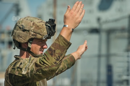 U.S. Army Spc. Robert Smedley, assigned to the 18th Field Artillery Brigade, 188th Brigade Support Battalion from Fort Bragg, N.C., directs military vehicles off Logistics Naval Vessel Cape Decision during Exercise Dragon Lifeline Aug. 7, 2019, at the Federal Law enforcement Training Center, S.C. The exercise provided military personnel with experience needed to support rapid deployment operations across air, land, rail and sea. JB Charleston helps to provide rapid global deployment of personnel and equipment is a capability that Joint Base Charleston helps to provide. The annual exercise is just one of the critical readiness exercises the DOD conducts to maintain a lethal and ready force. (U.S. Air Force photo by Tech. Sgt. Christopher Hubenthal)