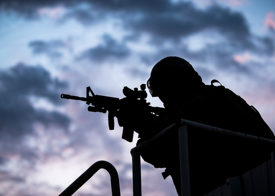 A Staff Weather Officer from the 3d Weather Squadron, fires an M4 Carbine during a certification field exercise (CFX), July 30, 2019, at Camp Bowie Training Center, Texas. The CFX was designed to evaluate the squadron's overall tactical ability and readiness to provide the U.S. Army with full spectrum environmental support to the Joint Task Force (JTF) fight. The CFX immersed Airmen into all the aspects of what could come with a deployment such as force on force scenarios. (U.S. Air Force photo by Airman 1st Class Eugene Oliver)