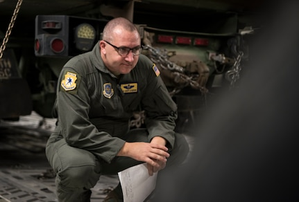 U.S. Air Force Tech Sgt. Scott Stueven, a load master assigned to the 437th Operations Group, inspects the aircraft cargo on a C-17 Globemaster III before departure as part of Exercise Dragon Lifeline August 8, 2019, at Joint Base Charleston, S.C. The deployment readiness exercise combined the capabilities of service members from Fort Bragg, N.C., Joint Base Charleston, S.C., and Joint Base Langley-Eustis, Va., focused on the rapid deployment of equipment, vehicles and personnel. Participants shared knowledge and tested their efficiency in moving assets by air, land, rail and sea during the training event. The annual exercise is just one of the critical readiness exercises the DOD conducts to maintain a lethal and ready force. (U.S. Air Force photo by Staff Sgt. Tenley Long)