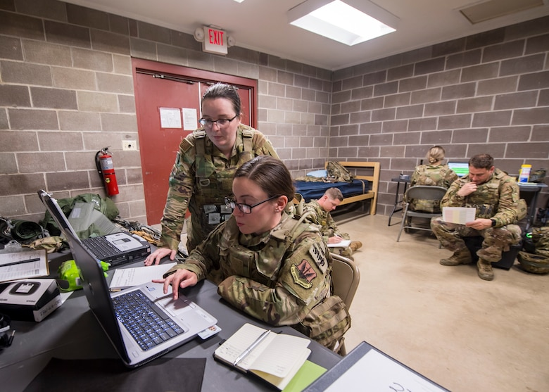 Staff Weather Officers from the 3d Weather Squadron (WS) input data into computers during a certification field exercise (CFX), July 29, 2019, at Camp Bowie Training Center, Texas. The CFX was designed to evaluate the squadron's overall tactical ability and readiness to provide the U.S. Army with full spectrum environmental support to the Joint Task Force (JTF) fight. While deployed, the Army relies on the 3d WS to provide them with current ground weather reports. These reports are then employed by commanders on the ground as they plan the best tactics and approaches to accomplish the mission. (U.S. Air Force photo by Airman 1st Class Eugene Oliver)