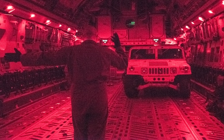 U.S. Air Force Tech Sgt. Scott Stueven, a load master assigned to the 437th Operations Group, marshals a Humvee off the ramp of a C-17 Globemaster III during Exercise Dragon Lifeline August 8, 2019, at Fort Bragg, N.C. The exercise provided military personnel with experience needed to support rapid deployment operations across air, land, rail and sea. JB Charleston helps to provide rapid global deployment of personnel and equipment to deployed locations across the globe. The annual exercise is just one of the critical readiness exercises the DOD conducts to maintain a lethal and ready force. (U.S. Air Force photo by Staff Sgt. Tenley Long)