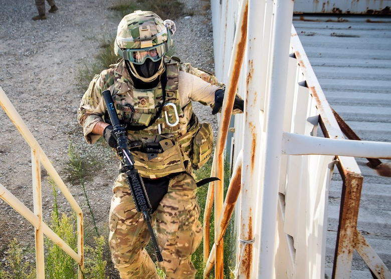 Master Sgt. James Kamphaus, 3d Weather Squadron mission support flight chief, climbs a flight of stairs during a certification field exercise (CFX), July 29, 2019, at Camp Bowie Training Center, Texas. The CFX was designed to evaluate the squadron's overall tactical ability and readiness to provide the U.S. Army with full spectrum environmental support to the Joint Task Force (JTF) fight. The CFX immersed Airmen into all the aspects of what could come with a deployment such as force on force on force scenarios. (U.S. Air Force photo by Airman 1st Class Eugene Oliver)