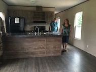 Amy Dixon takes a tour of her new mobile home unit that was turned over Aug. 9, 2019, upon completion through the RISE West Virginia program.