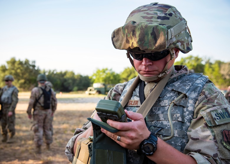 Master Sgt. Ryan Kegler, 3d Weather Squadron Det 1 section chief of division weather operations, reads a defense advanced GPS receiver during a certification field exercise (CFX), July 31, 2019, at Camp Bowie Training Center, Texas. The CFX was designed to evaluate the squadron's overall tactical ability and readiness to provide the U.S. Army with full spectrum environmental support to the Joint Task Force (JTF) fight. The CFX immersed Airmen into all the aspects of what could come with a deployment such as Land Navigation. (U.S. Air Force photo by Airman 1st Class Eugene Oliver)