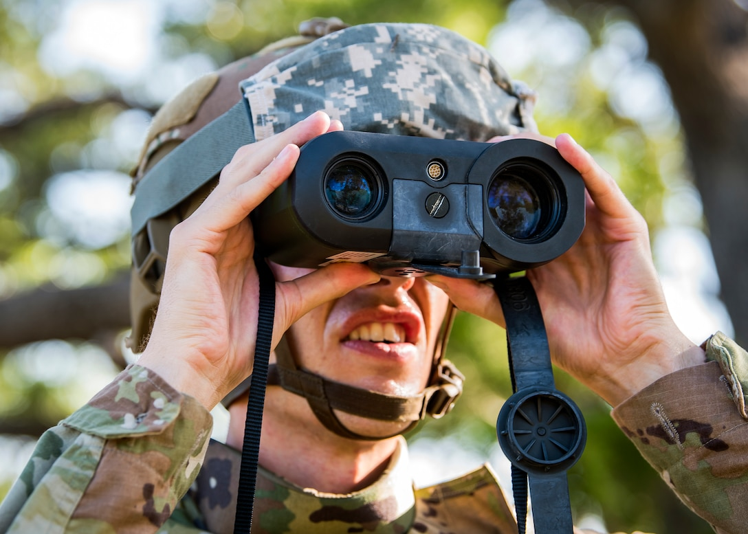 Airman 1st Class Mark Dunlop, 3d Weather Squadron weather forecaster, utilizes a laser range finder to locate a check point during a certification field exercise (CFX), July 31, 2019, at Camp Bowie Training Center, Texas. The CFX was designed to evaluate the squadron's overall tactical ability and readiness to provide the U.S. Army with full spectrum environmental support to the Joint Task Force (JTF) fight. The CFX immersed Airmen into all the aspects of what could come with a deployment such as Land Navigation. (U.S. Air Force photo by Airman 1st Class Eugene Oliver)