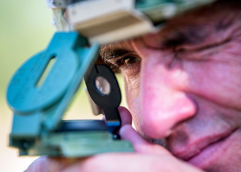 Master Sgt. James Kamphaus, 3d Weather Squadron mission support flight chief, reads a compass during a certification field exercise (CFX), July 31, 2019, at Camp Bowie Training Center, Texas. The CFX was designed to evaluate the squadron's overall tactical ability and readiness to provide the U.S. Army with full spectrum environmental support to the Joint Task Force (JTF) fight. The CFX immersed Airmen into all the aspects of what could come with a deployment such as Land Navigation. (U.S. Air Force photo by Airman 1st Class Eugene Oliver)