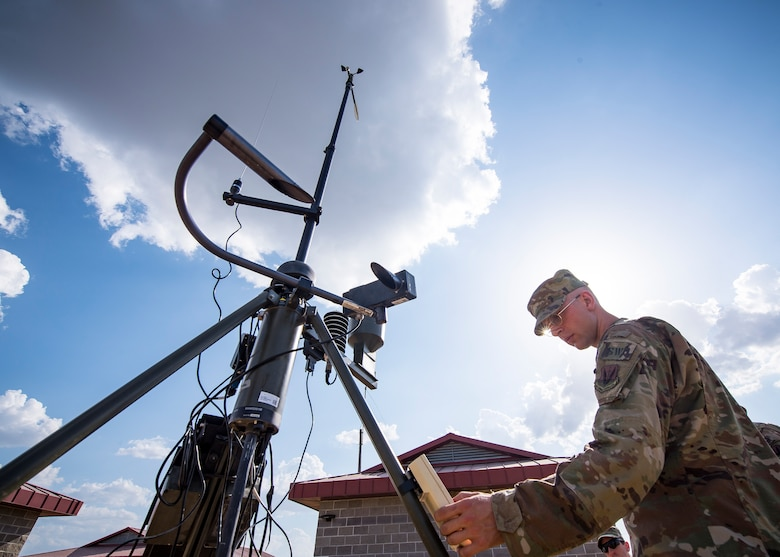 A Staff Weather Officer from the 3d Weather Squadron (WS) operates a tactical meteorological observing system during a certification field exercise (CFX), July 31, 2019, at Camp Bowie Training Center, Texas. The CFX was designed to evaluate the squadron's overall tactical ability and readiness to provide the U.S. Army with full spectrum environmental support to the Joint Task Force (JTF) fight. While deployed, the Army relies on the 3d WS to provide them with current ground weather reports. These reports are then employed by commanders on the ground as they plan the best tactics and approaches to accomplish the mission. (U.S. Air Force photo by Airman 1st Class Eugene Oliver)