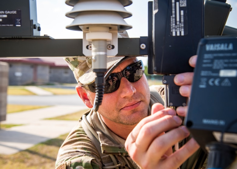 Staff Sgt. Richard Wilson, 3d Weather Squadron (WS) weather forecaster, installs a component of a tactical meteorological observing system during a certification field exercise (CFX), July 31, 2019, at Camp Bowie Training Center, Texas. The CFX was designed to evaluate the squadron's overall tactical ability and readiness to provide the U.S. Army with full spectrum environmental support to the Joint Task Force (JTF) fight. While deployed, the Army relies on the 3d WS to provide them with current ground weather reports. These reports are then employed by commanders on the ground as they plan the best tactics and approaches to accomplish the mission. (U.S. Air Force photo by Airman 1st Class Eugene Oliver)