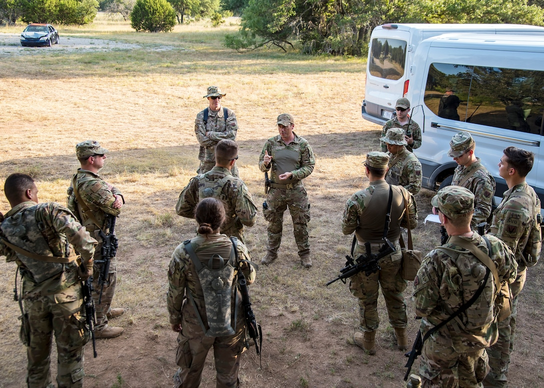 Master Sgt. Charles Kuykendall, center, 3d Weather Squadron operations superintendent, gives instruction during a certification field exercise (CFX), July 31, 2019, at Camp Bowie Training Center, Texas. The CFX was designed to evaluate the squadron's overall tactical ability and readiness to provide the U.S. Army with full spectrum environmental support to the Joint Task Force (JTF) fight. The CFX immersed Airmen into all the aspects of what could come with a deployment such as Land Navigation. (U.S. Air Force photo by Airman 1st Class Eugene Oliver)