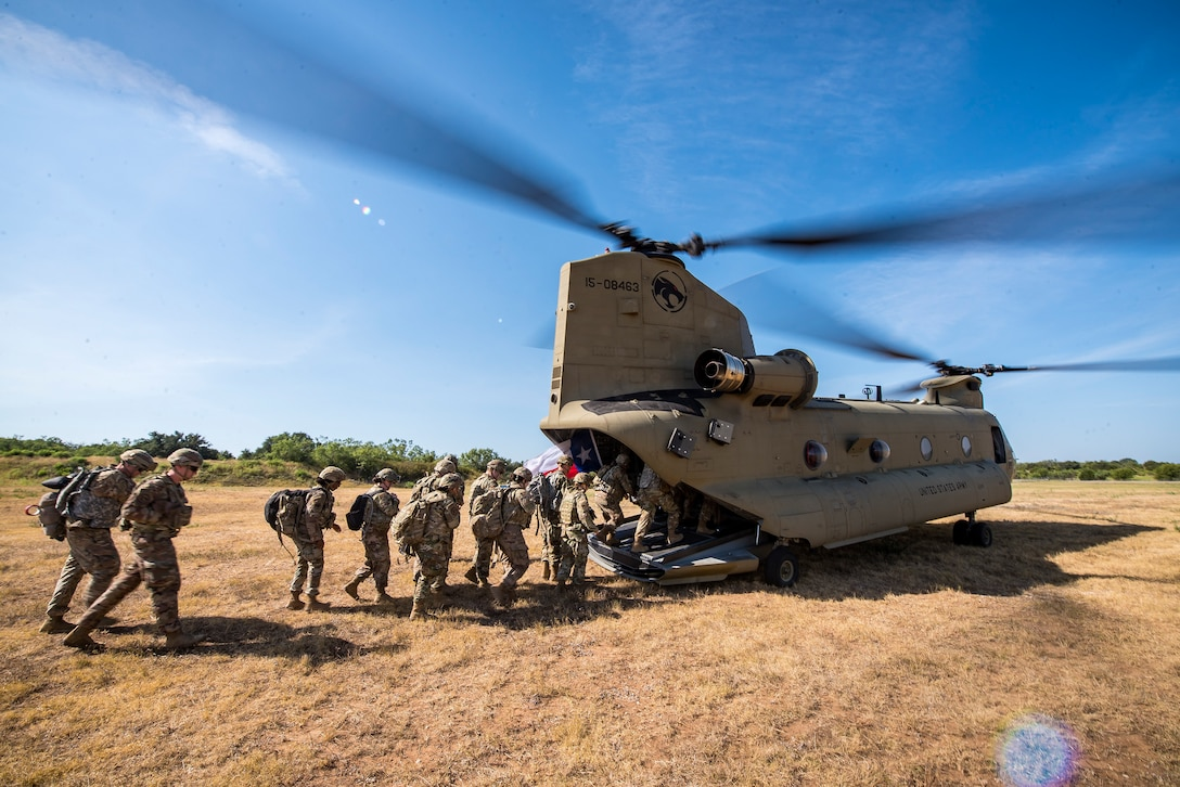 Airmen from the 3d Weather Squadron (WS) enter a CH47-Chinook following a certification field exercise (CFX), August 2, 2019, at Camp Bowie Training Center, Texas. The CFX was designed to evaluate the squadron's overall tactical ability and readiness to provide the U.S. Army with full spectrum environmental support to the Joint Task Force (JTF) fight. While deployed, the Army relies on the 3d WS to provide them with current ground weather reports. These reports are then employed by commanders on the ground as they plan the best tactics and approaches to accomplish the mission. (U.S. Air Force photo by Airman 1st Class Eugene Oliver)