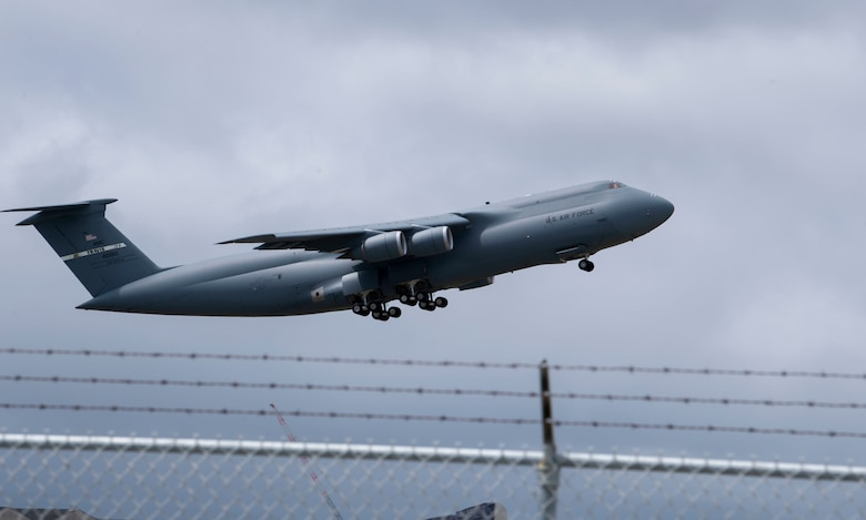 A C-5C Galaxy departs April 20, 2019, from Sunnyvale, California. The C-5, which is assigned to Travis Air Force Base, California, transported the satellite to Florida. The satellite, was launched into space Aug. 8 and will provide enhanced communications for high-priority military assets.  (U.S. Air Force Photo by Airman 1st Class Jonathan Carnell)