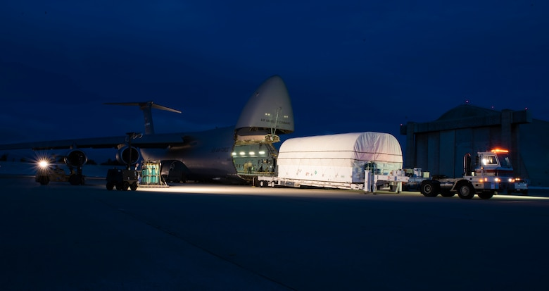 U.S. Air Force Airmen from Team Travis, Space and Missile Systems Center personnel and civilian ground crews load the fifth Advanced Extremely High Frequency communications satellite into a C-5C Galaxy April 19, 2019, at Sunnyvale, California, to transport to Florida. The satellite, was launched into space Aug. 8 and will provide enhanced communications for high-priority military assets.  (U.S. Air Force Photo by Airman 1st Class Jonathan Carnell)