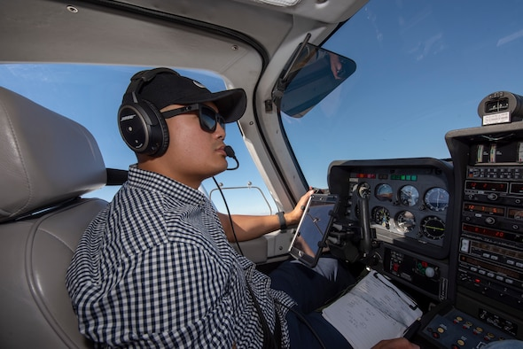 U.S. Air Force Tech. Sgt. Ron, 860th Aircraft Maintenance Squadron flight line expediter, mans the controls of a Socata Trinidad TB-20 July 27, 2019, during a flight over the San Francisco Bay Area. Ron has accumulated more than 250 flying hours and completed Air Force remote pilot aircraft training July 12. (U.S. Air Force photo by Tech. Sgt. James Hodgman)