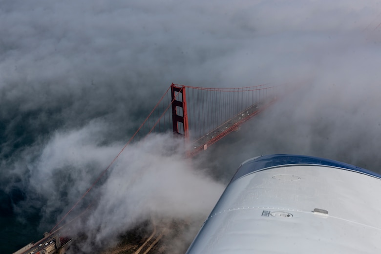 The Golden Gate Bridge is visible from a Socata Trinidad TB-20 aircraft July 27, 2019, during a flight over the San Francisco Bay Area. The plane was piloted by U.S. Air Force Tech. Sgt. Ron, 860th Aircraft Maintenance Squadron flight line expediter. Ron has accumulated more than 250 flying hours and completed Air Force remote pilot aircraft training July 12. (U.S. Air Force photo by Tech. Sgt. James Hodgman)